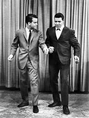 "Chubby Checker explaining The Twist to Dick Clark on ""American Bandstand."""