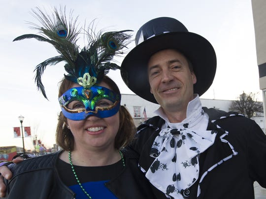 Lisa and David Doerner, of Avon, got in the Mardi Gras spirit with costumes at Speedway's  2015 Mardi Gras on Main. The event features New Orleans-inspired meals and signature cocktails at local businesses. Win a prize for best costume.