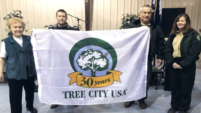 Shown at the Arbor Day program from left are Yvonne McGee, REVIVA coordinator; Tim Taylor, Iva Town Clerk; and Lowe Sharp and Dena Whitesides, both of the S.C. Forestry Commission.