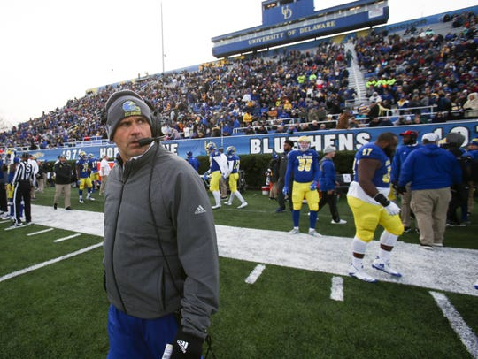 Delaware head coach Danny Rocco eyes the scoreboard before the Blue Hens' 22-3 win against Albany at Delaware Stadium in November 2017.