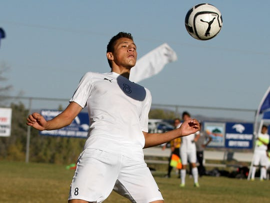 Piedra Vista's Angel Flores gets the ball under control during a game against Rio Rancho on Saturday at the Piedra Vista soccer fields in Farmington.