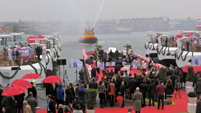 Viking Cruises CEO Torsten Hagen, the captains and godmothers of the twelve new ships braved a chilly drizzle and gathered on a platform at the Amsterdam passenger terminal to induct each vessel.