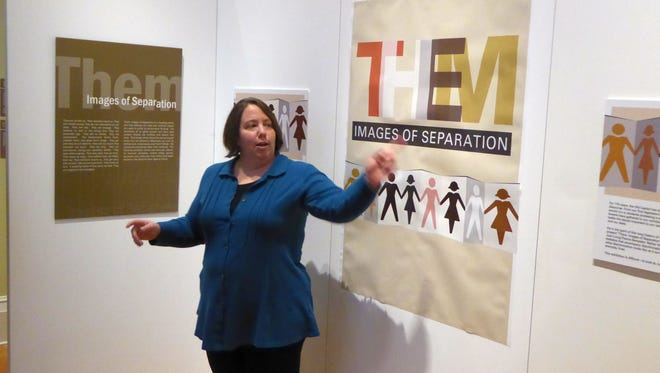 "Director Trina Roberts provides a tour of the Old Capitol Museum's newest exhibit, ""Them: Images of Separation."""