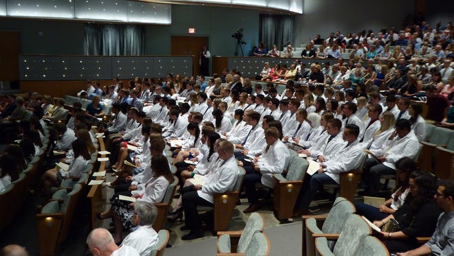 First-year medical students sit Friday in Hancher Auditorium during the Carver College of Medicine's annual White Coat Ceremony.