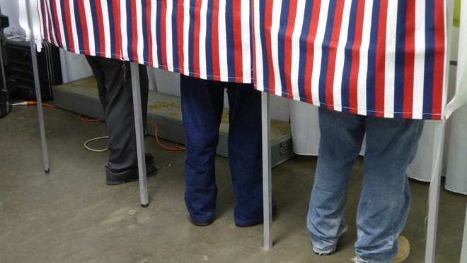 Voters cast their ballots in West Liberty.  ​