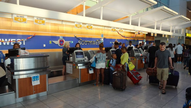 This file photo from July 1, 2014, shows the Southwest Airlines ticket counter at Baltimore/Washington International Airport.