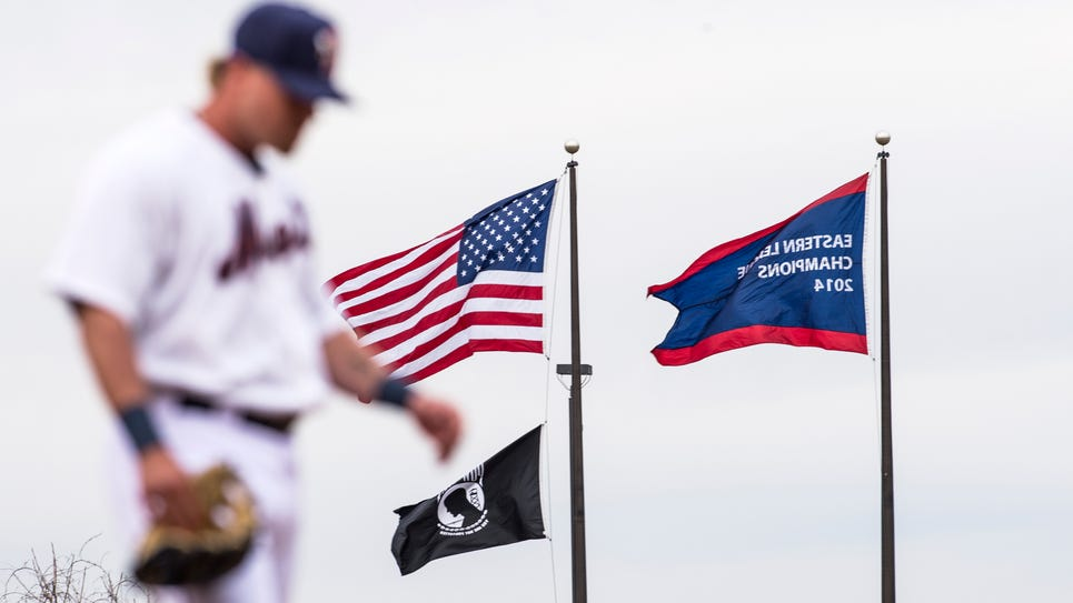 The 2014 Eastern League championship banner flies behind