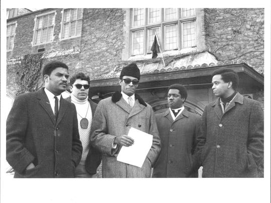 Rev. John S. Walker, center, in March 1969. He was one of the Black Student Caucus' spokesmen.