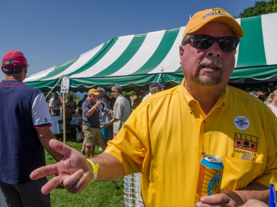 Larry Bell, owner of Bell's Beer, talks about the race and being the sailboat Details Tuesday, July 19, 2016 during the Port Huron-to-Mackinac Island Sailboat Race awards party at Mackinac Island.