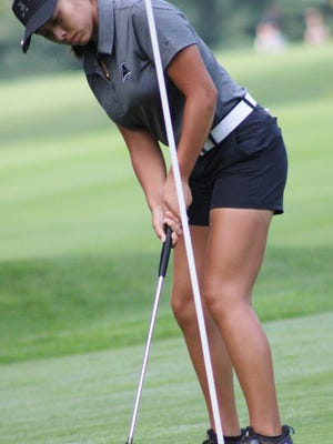 Brooklyn Millard converts a birdie putt during Aurora's third-place finish in the American Conference at the second of the four Suburban League tournaments Wednesday at Brookledge Golf Club in Cuyahoga Falls. Millard shot a 71 to earn medalist honors.