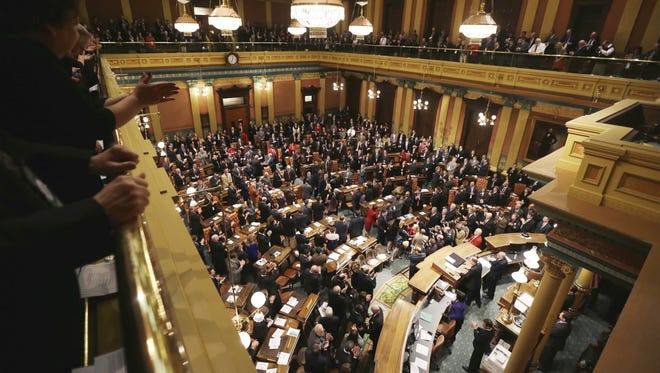 Michigan Gov. Rick Snyder enters the joint session of the state Legislature before delivering his third annual State of the State address in the Capitol in Lansing.