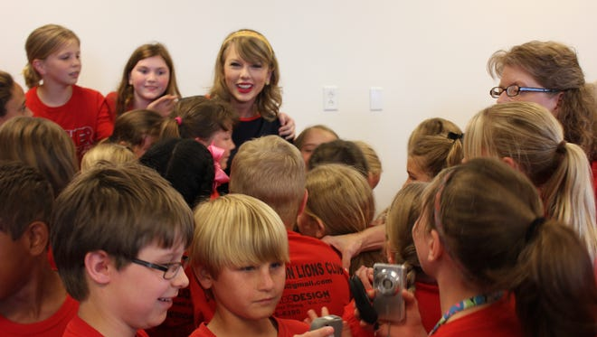 Taylor Swift meets a group of fourth graders at the Taylor Swift Education Center on Wednesday, May 14, 2014.