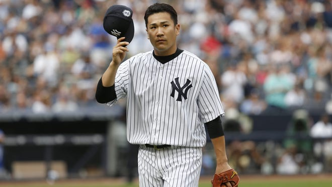 Yankees starting pitcher Masahiro Tanaka tips his cap as he leaves the game during the sixth inning against the Toronto Blue Jays on Sunday.