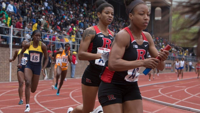 Rutgers Phyllis Gordan of Neptune hands off to Alayna Famble during women's 4X200 final. Saturday events at Penn Relays in Philadelphia Pa, on April 30, 2016.