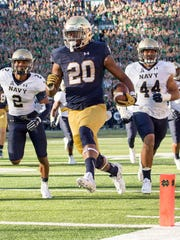 Notre Dame running back C.J. Prosise (20) runs for a touchdown  against Navy.