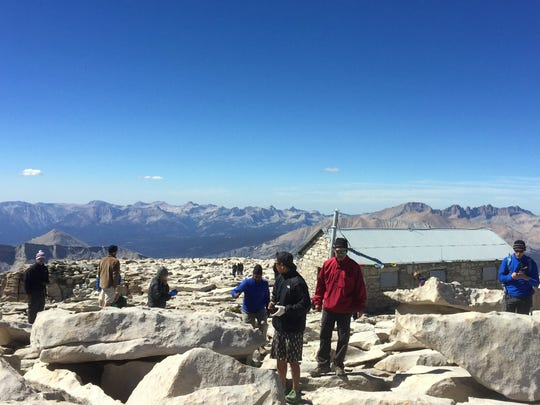 Crowds are a regular occurrence at the top of Mt. Whitney, the highest point in the lower 48 states at 14,505 feet.