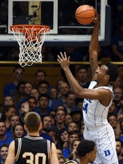 Duke's Wendell Carter Jr. throws down a dunk in the first half of Wednesday's game.