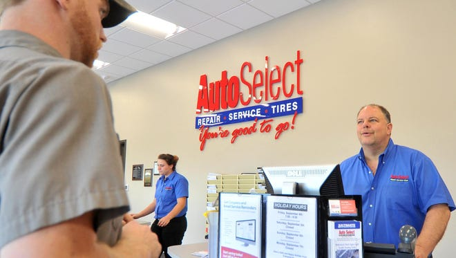 Service advisor Paul Waraska helps a customer Thursday at the new Auto Select location off Schofield Avenue in Schofield.