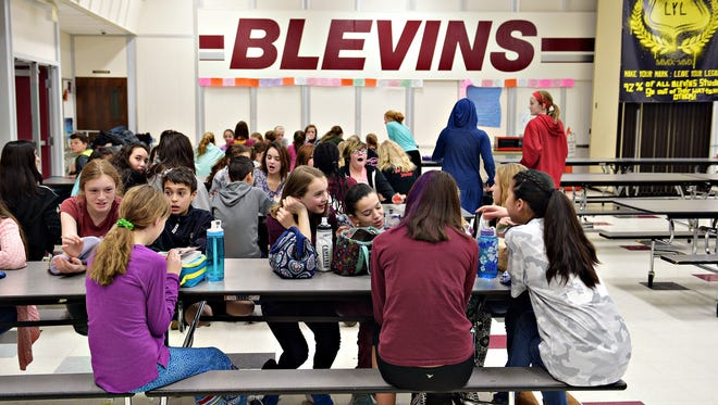 Students socialize at the end of their lunch period at Blevin's Middle School on Wednesday, February 1, 2017. Enrollment at Blevins and other PSD schools fell short of projections, resulting in a nearly $2.6 million funding shortage.