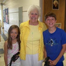 Flossie Tonda took pictures and was escorted by students Taylor Burris and Devin Willmer during a 2010 visit to her namesake school, Tonda Elementary in Canton.