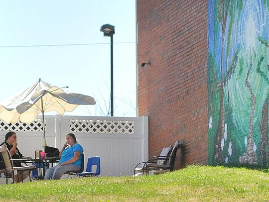 Two women enjoy the warm weather Wednesday afternoon