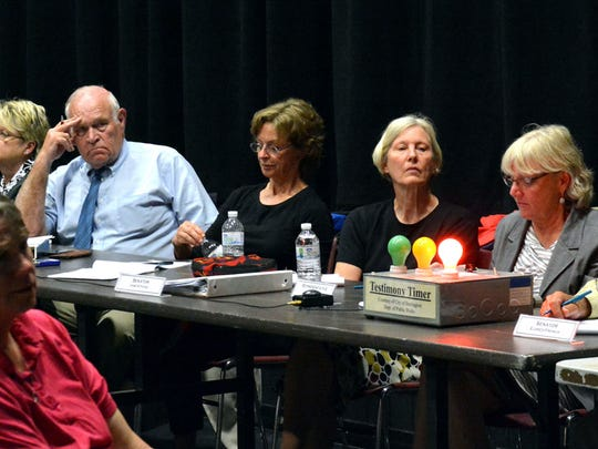 A panel of Vermont legislators takes public testimony during a hearing on child protection Tuesday evening in Rutland. The panel is starting a tour to get a public perspective on how well the state agency charged with protecting children is doing.