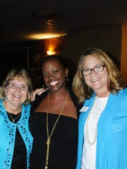 L-R Past Board Chair Pamela Aveling, First Lady of Tallahassee R Jai Gillum ( a 2014 DoveTales speaker) , and Lee's Place Director of Development Beth Tedio.