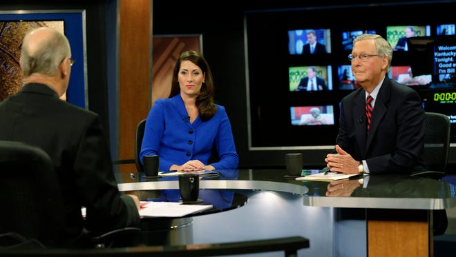 Sen. Mitch McConnell (right) and challenger Alison Lundergan Grimes (left) before a debate.