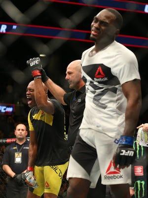 Anderson Silva (red gloves) celebrates after his victory against Derek Brunson (blue gloves) during UFC 208 at Barclays Center.