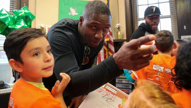 Cincinnati Bengals defensive end Carlos Dunlap visits the Sarah Heinz House, a member of the Boys & Girls Clubs of America, a stop on Dunlap's Literacy Campaign to tackle