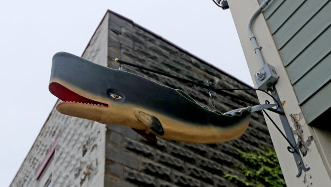 A whale hangs outside the Lost Whale bar, 2151 S. Kinnickinnic Ave. in Bay View. The bar opens to the public June 28, with a grand opening around July 4.