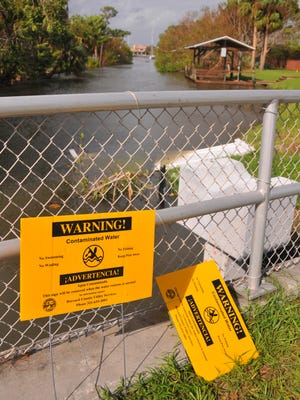 Warning signs for contaminated water were posted recently at the canal and retention pond on Anchor Drive off of South Patrick.