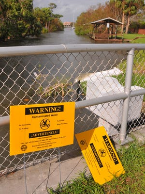 Warning signs for contaminated water have been posted periodically in recent years at the canal and retention pond on Anchor Drive off of South Patrick, where sewage spills are common. FLORIDA TODAY FILE PHOTO Warning signs for co