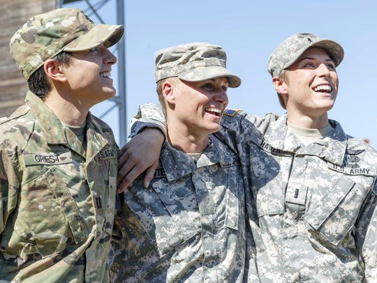 Maj. Lisa Jaster, center, became the 3rd woman to graduate