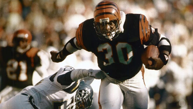 Ickey Woods breaks the tackle by San Diego Charger Vencie Glenn on his 30-yard touchdown run in the first half of this December 1988 game at Riverfront Stadium. Woods rushed for two touchdowns and 141 yards, helping the Bengals beat the Chargers 27-10.