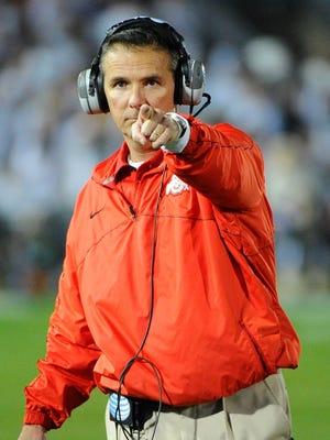 Ohio State coach Urban Meyer and the Buckeyes went unbeaten last year.