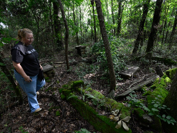 Denise Hardin walks through overgrown parts of Antioch Cemetery in Montgomery, Ala. on Tuesday June 24, 2014.