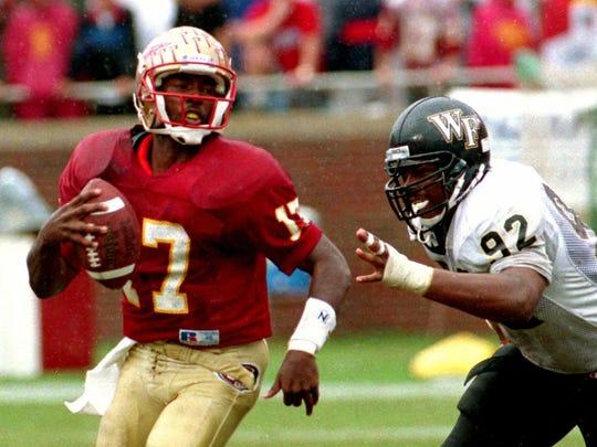FSU quarterback Charlie Ward escapes a pass rush during