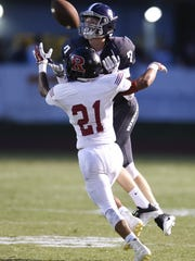 Ravenwood Ramez Ibrahim (21) gets called for pass interference