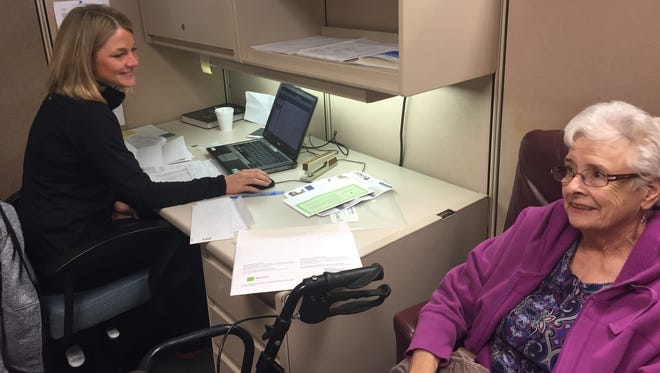 Erin Nielsen, a senior at Walsh College, volunteers and prepares taxes for free for Sandy Singley at the Accounting Aid Society office in Ferndale.
