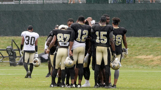 Saints team spirit in the rain during the 13th day of Saints training camp at the Greenbrier resort in White Sulphur Springs, W. Va.