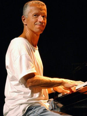 Pianist Keith Jarrett smiles during a sound check prior to his concert at Montreux Jazz Festival in 2002.