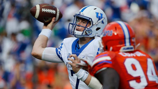 Sep 10, 2016; Gainesville, FL, USA;Kentucky Wildcats quarterback Drew Barker (7) throws the ball as Florida Gators defensive lineman Bryan Cox (94) rushes during the first half at Ben Hill Griffin Stadium.