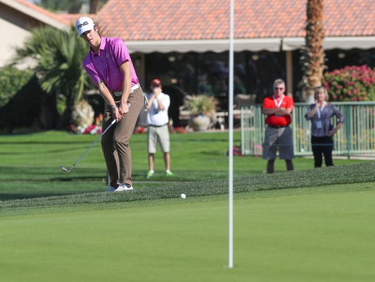 Palm Desert High School senior Charlie Reiter hits a shot from just off the sixth green at the La Quinta Country Club during the CareerBuilder Challenge, January 18, 2018.