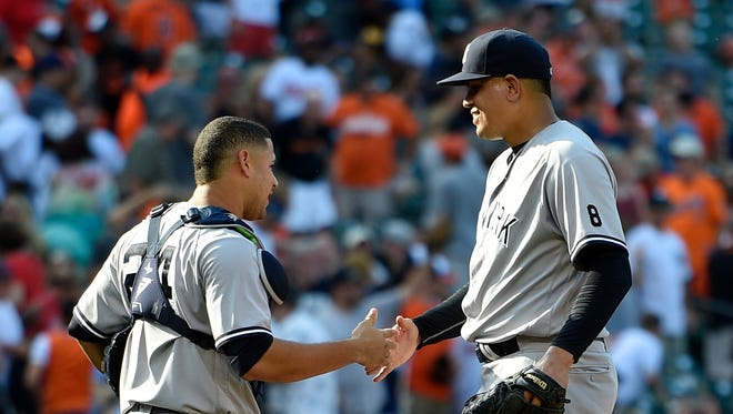New York Yankees relief pitcher Dellin Betances, right, celebrates a 5-2 win over the Baltimore Orioles with catcher Gary Sanchez (24) after a baseball game, Sunday, Sept. 4, 2016, in Baltimore.