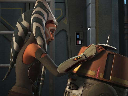 Ahsoka Tano greets the droid Chopper on the season