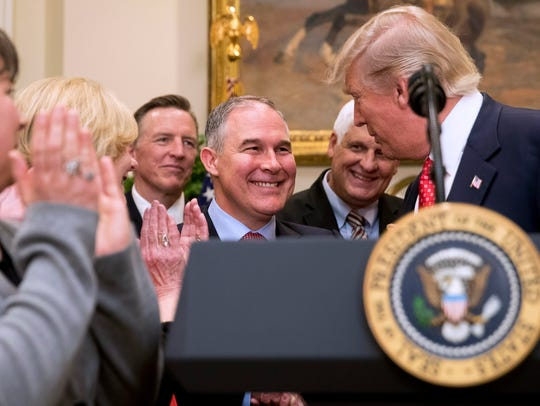 Trump shakes hands with Pruitt before signing the Waters