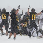 Pewamo-Westphalia celebrates a fourth quarter touchdown, sealing P-W's 30-0 win over Detroit Loyola, November 21, 2015, during the Division 7 semifinal at Fenton High School.