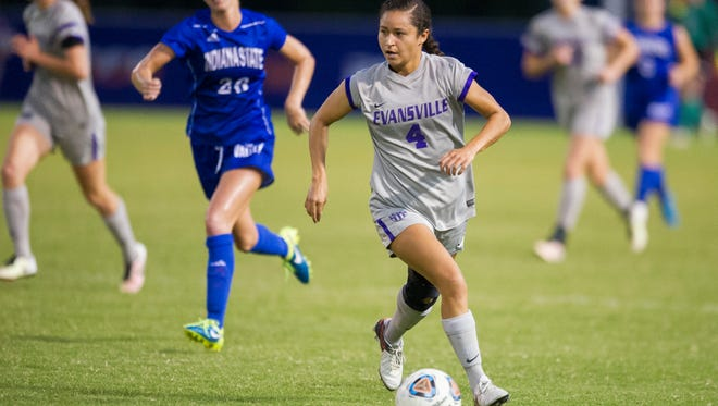 Evansville's Nicki Baham (4) moves the ball downfield past Indiana State's Brice Bement (26) during their game at Arad McCutchan Stadium in Evansville, Wednesday, Oct. 19, 2016.