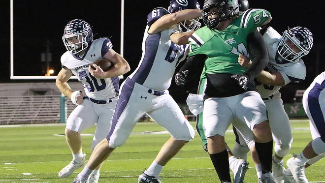 Greenwood's Hunter Wilkinson looks for running room behind his offensive line in the first quarter against Van Buren on Oct. 30 at Blakemore Field.